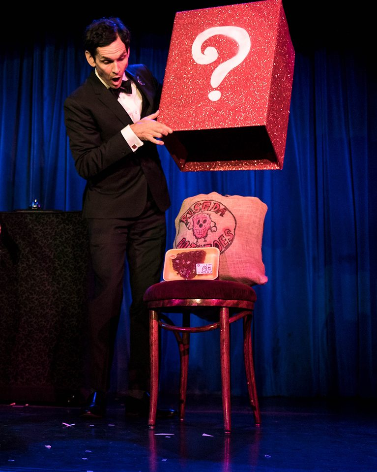 magician doing trick on stage
